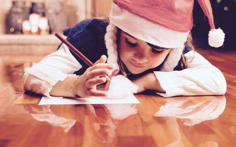 Christmas scene. girl writing aletter
